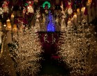 Among the figurines were several lit-up Chirstmas trees and a life-size Santa Claus upon whose lap spectators could sit.
