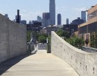 The walled pathway of the Newtown Creek Nature Walk, perfectly framing the Empire State Building.