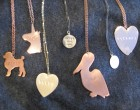 From left to right these customizable pendants from Metal Sugar read: Dirty, Gay, BKLYN, Honey Boo Boo, WTF, 11211 and Untamed. Design one for your sweetheart, sister, bestie or baby.