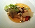 Smoked cannellini bean tofu in a caramelized onion broth alongside fennel, celery root crisps and veggies.