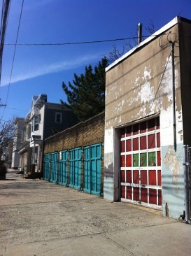 One of the colorful garages in the author's new neighborhood that she wishes would become a restaurant with sidewalk seating. (It will, eventually.)