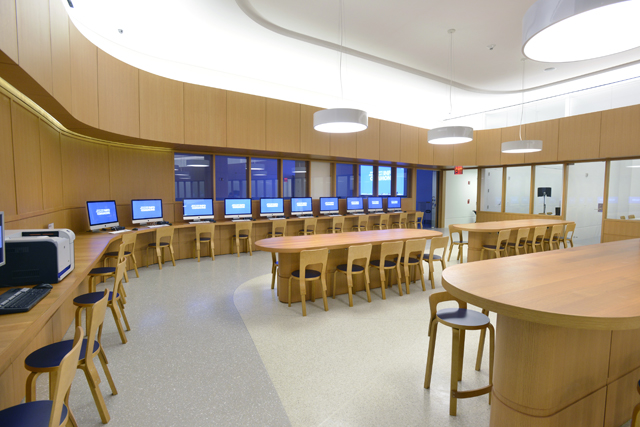 The Information Commons at the Brooklyn Public Library Central branch offers ample desktop space and outlets to match. Photo: Philip Greenberg