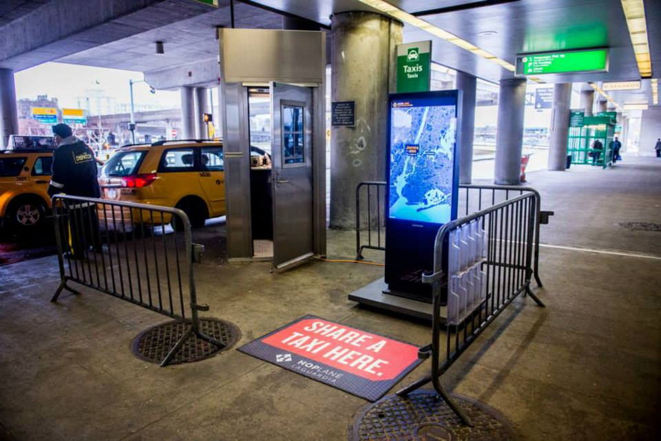 A new startup Bandwagon uses apps and ride sharing to reduce the cost of cab rides to and from LaGuardia Airport. Photo: Bandwagon