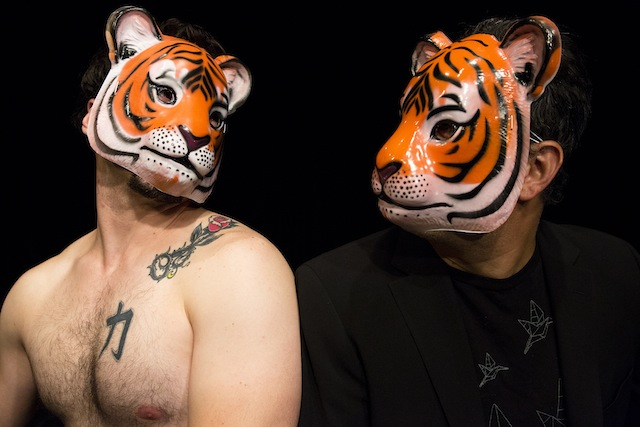 """Actor Nic Grelli makes a pass at Bobby Plasencia in a scene from """"Boat in a Tiger Suit,"""" which opens at Brick Theater on Thursday. Photo: Hunter Canning"""