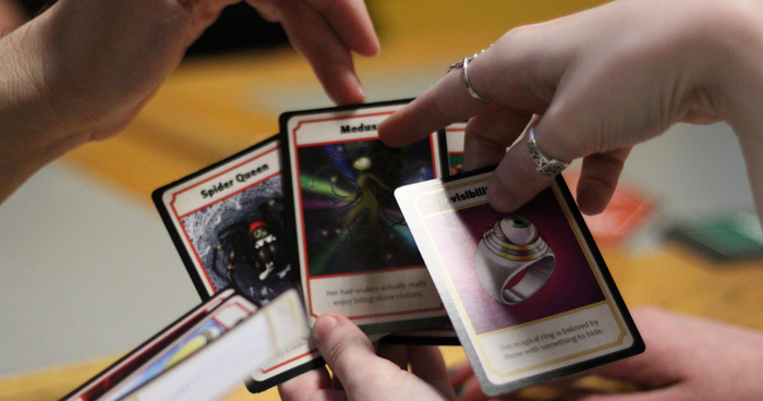 Players navigate the character cards while testing out Story War. Photo: Cantrip Games