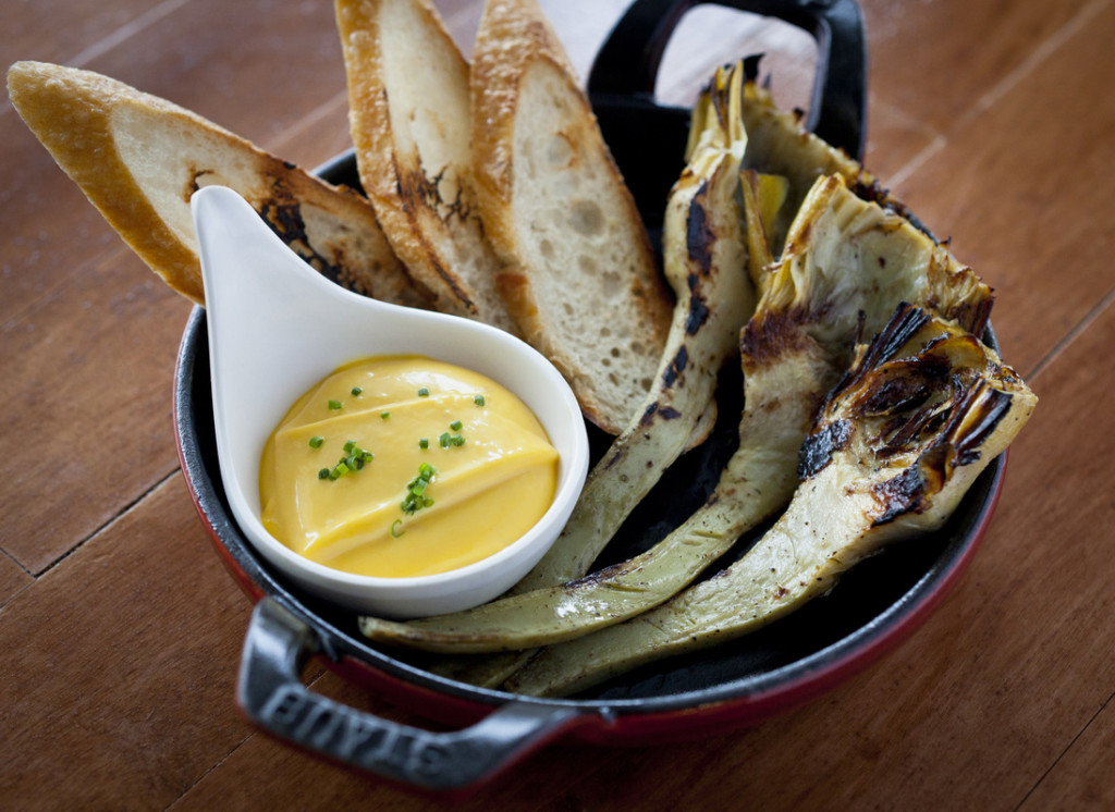 Bring your own booze to Grilled artichokes with saffron aioli at Bistro Petit (Photo courtesy Bistro Petit / Todd Barndollar)