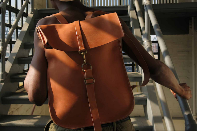 The craftsmanship of Kika NY's hand-cut leather bags, like its signature Postal BackPack No. 1, sells itself, but having a shirtless model show them off never hurts. Photo: Kika NY