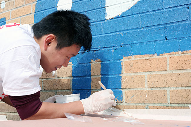 Over 6,000 New York Cares volunteers helped revitalize local public schools in October, as part of its semiannual volunteer days. The nonprofit is currently looking for holiday help. Photo: Daniel Broadhurst