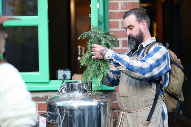 Obi Kaufmann of Juniper Ridge puts trimmings from a cedar tree into a bourbon still converted to extract essential oils from organic matter. Photo: Daniel Broadhurst