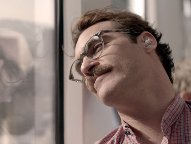 "Despite never seeing her in person (and that she's an artificially intelligent OS system) Joaquin Phoenix falls for Scarlett Johansson in the new film ""Her."" There's still a chance to catch to a sneak preview of the flick at BAM on Dec. 9. Photo: Warner Bros. Pictures"