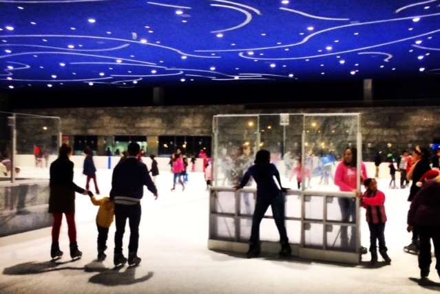 "Skating onto the covered rink at the new LeFrak Center, beneath its starry ""sky."" Photo: Kate Hooker"