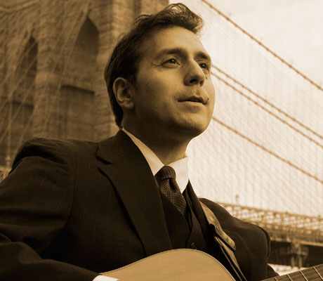"""Steve Zelin, aka """"The Singing C.P.A."""" is a maestro wtih tax codes and on the guitar. Photo: Daniel Neuburger"""