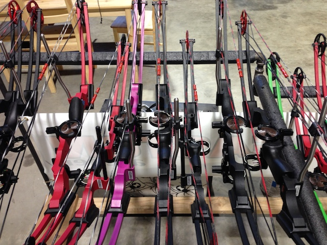 Compound bows sit ready for apple splitting. Photo: Brooklyn Based