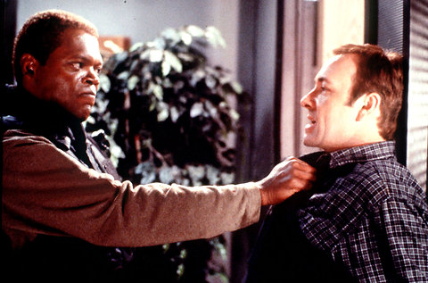 Samuel L. Jackson's body language is WAY too aggressive for a good negotiation.