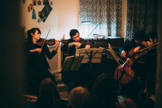 A quartet plays one of Groupmuse's signature house parties in Crown Heights. Photo: Thomas Grenier