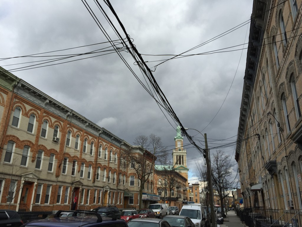 stretch of houses down Catalpa Avenue, with St. Matthias Roman Catholic church off in the distance. Photo: Regina Mogilevskaya