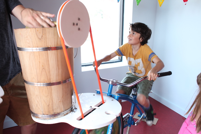 Kids learn physics by making ice cream on a bike at Ample Hills Creamery. Photo: Lauren Adams