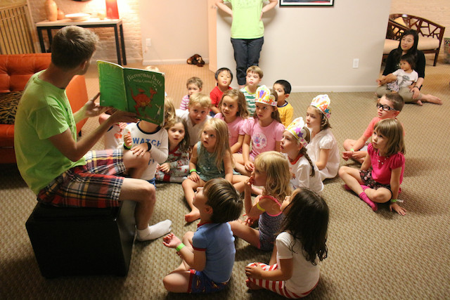 Storytime is just one of the activities kids can look forward to at a Project Playdate. A dance party, open play, arts and crafts, dinner and a movie round out the night. Photo: Chika Ibe