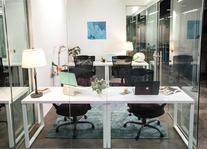 Office featuring wood artwork by Justin Horowitz, photo by Keziban Barry