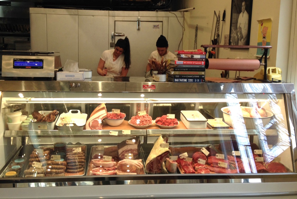 Cara Nicoletti and Matthew Dale at work behind the butcher counter. Photo: Annaliese Griffin