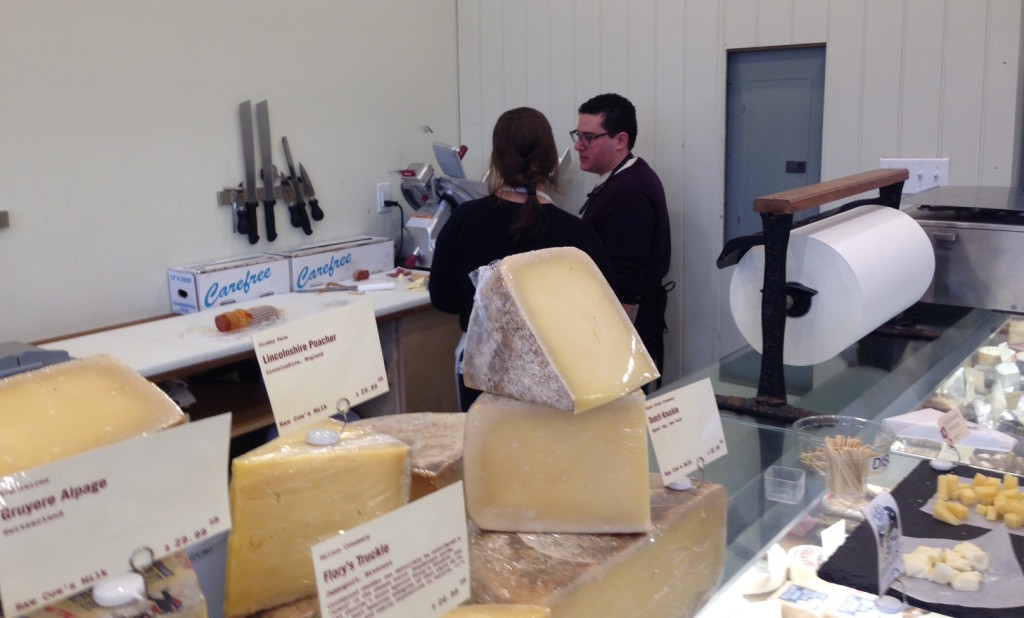 Aaron Foster, at right, shows a cheesemonger the finer points of slicing pancetta. Photo: Annaliese Griffin