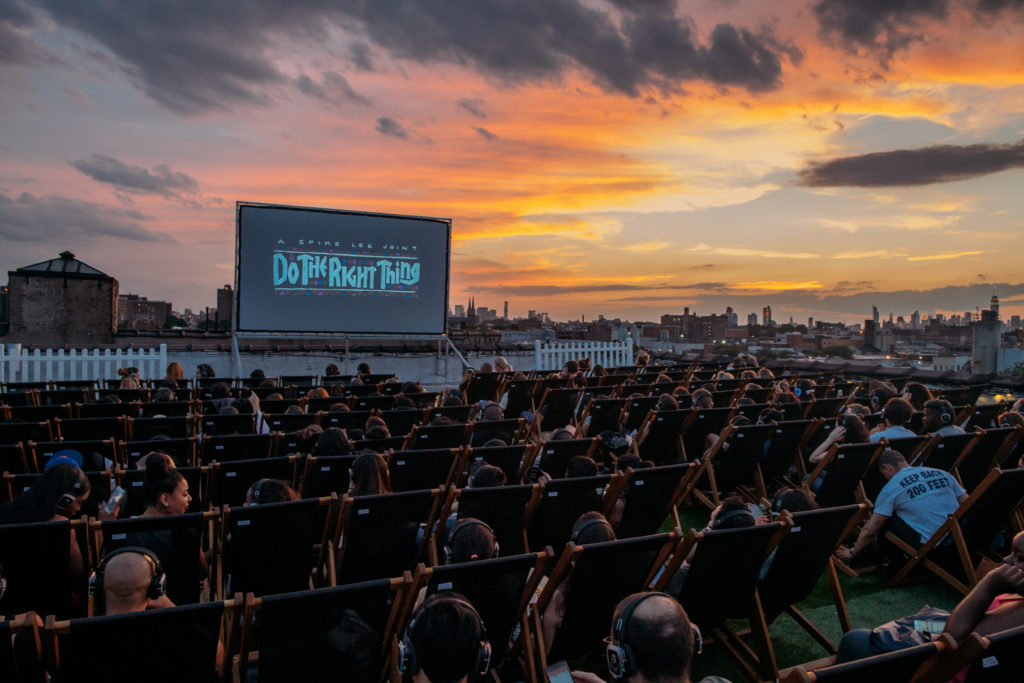 If you love the idea of outdoor movies, but hate sitting on a blanket, you can upgrade the experience. Photo: Rooftop Cinema Club