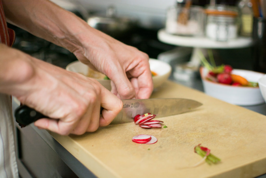 Volger slices radishes. Photo: Spencer Starnes