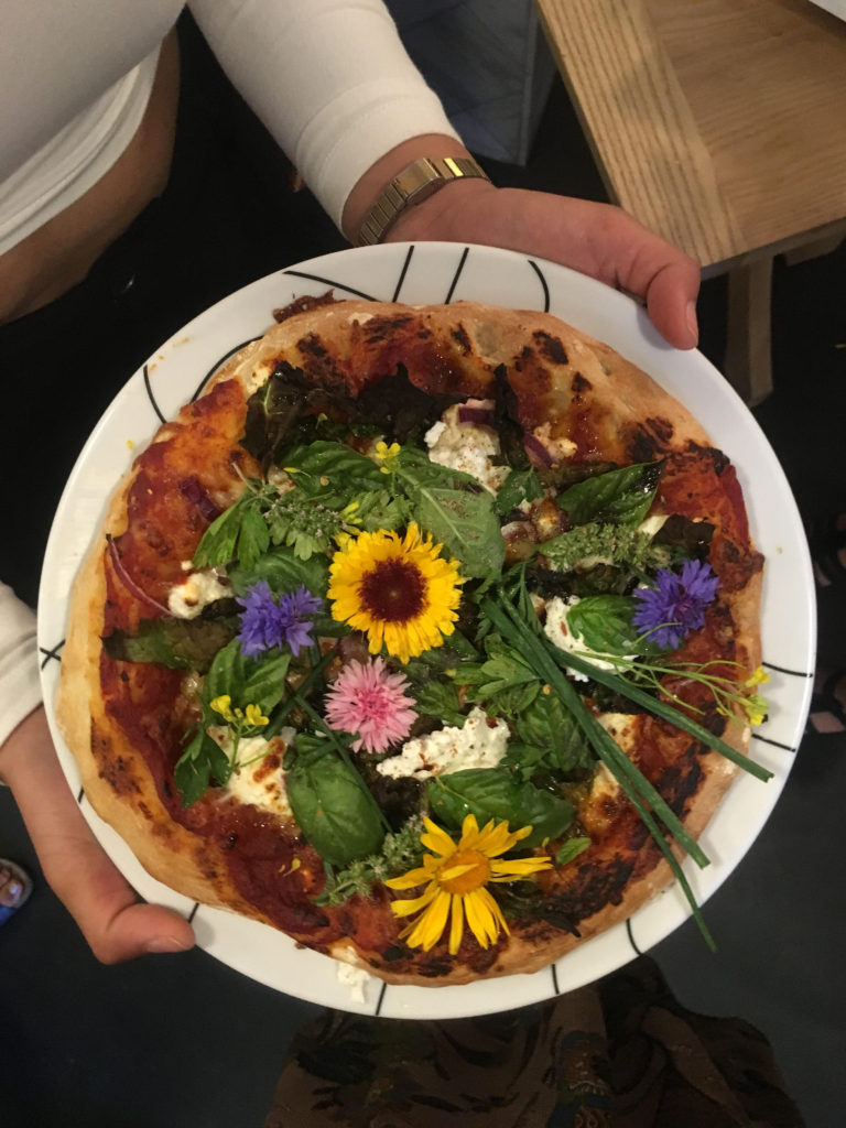 The prettiest pizza in town comes courtesy of a partnership between Eagle Street Rooftop Farm and Archstratus Books. Photo: Annie Novak