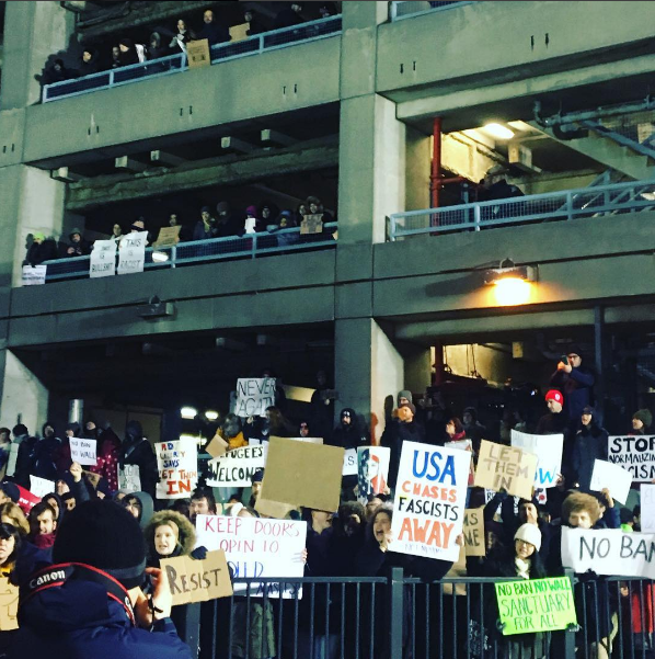 Protestors flocked to JFK Airport on Saturday to stand with immigrants and refugees. Photo: Kate Hooker