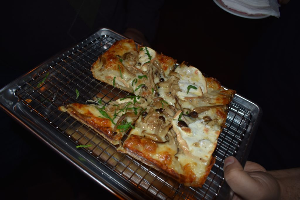 Detroit-style pizza shows up on the Asian-influences sports bar menu, of course. Photo: Georgia Kral