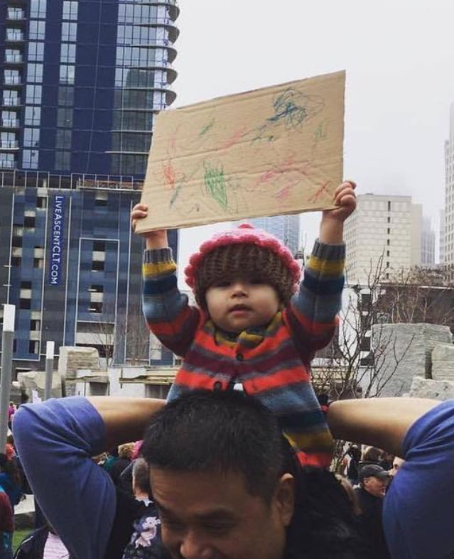 Woke babies are the best. This photo of a tiny protester proves how amazing it is to bring kids to rally.