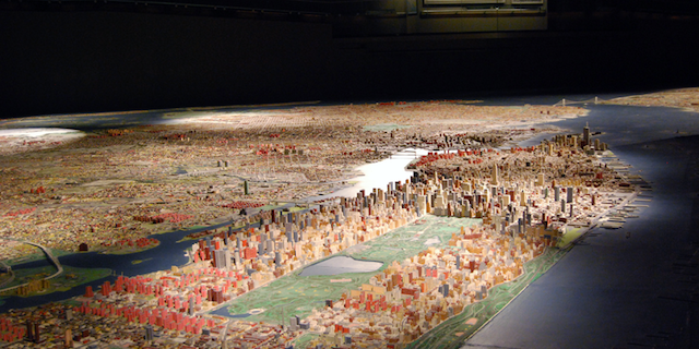 The Panorama at the Queens Museum becomes a trivia prop during the Panorama Challenge. Photo: Queens Museum.
