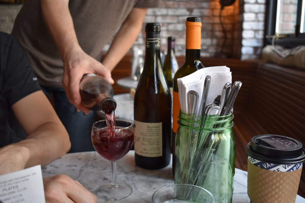 Pouring a glass of natural wine at Ops. Photo: Georgia Kral