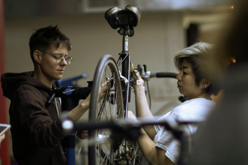 Denise Mei and Cait McLaughlin team up at class 3 of the W/T/F Bicycle Repair and Maintenance Intensive on March 29 at the Lutheran Church of St John the Evangelist in Brooklyn for women/trans/non-binary identifying individuals. Photo: Kate Ryan