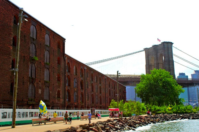 THE FENCE at Photoville stretches over 1,000 feet through Brooklyn Bridge Park. Photo: UPI: Seth Johnson