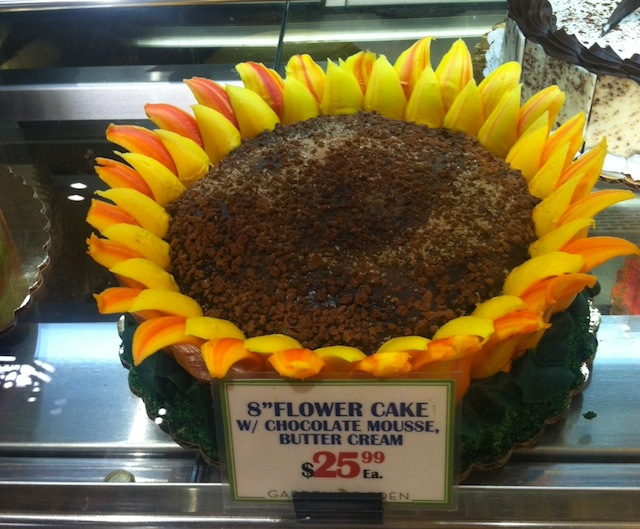 Serve some gummy worms alongside this sunflower cake and you've got an instant garden party. Photo: Garden of Eden