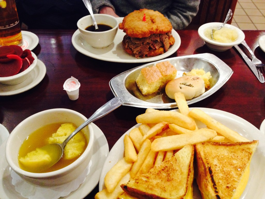A full table of greasy comfort food (and free pre-meal snacks) at Junior's. Photo: Brendan Spiegel