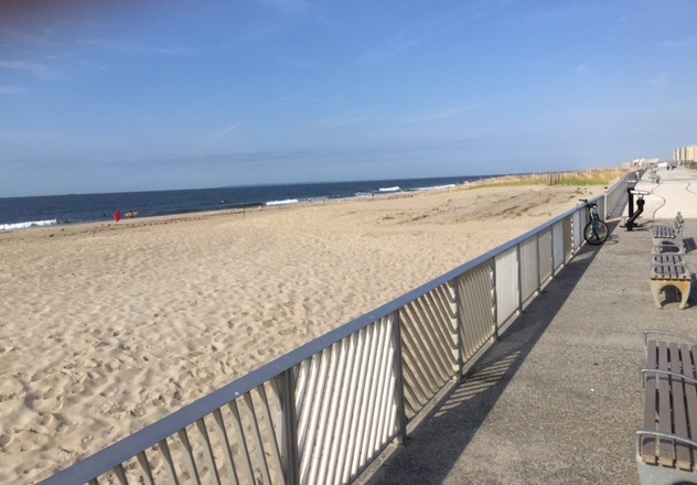 Much of the Rockaway boardwalk has been rebuilt, replacing wood damaged by Sandy with nearly indestructible concrete. Photo: Nicole Davis