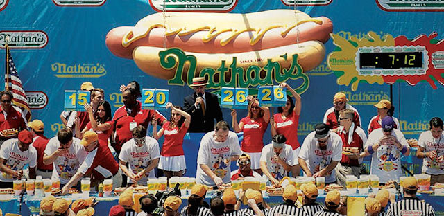 It's July 4th, and what better way to celebrate than to watch our country's best competitive eaters scarf down hot dogs in Coney? Photo: Nathan's