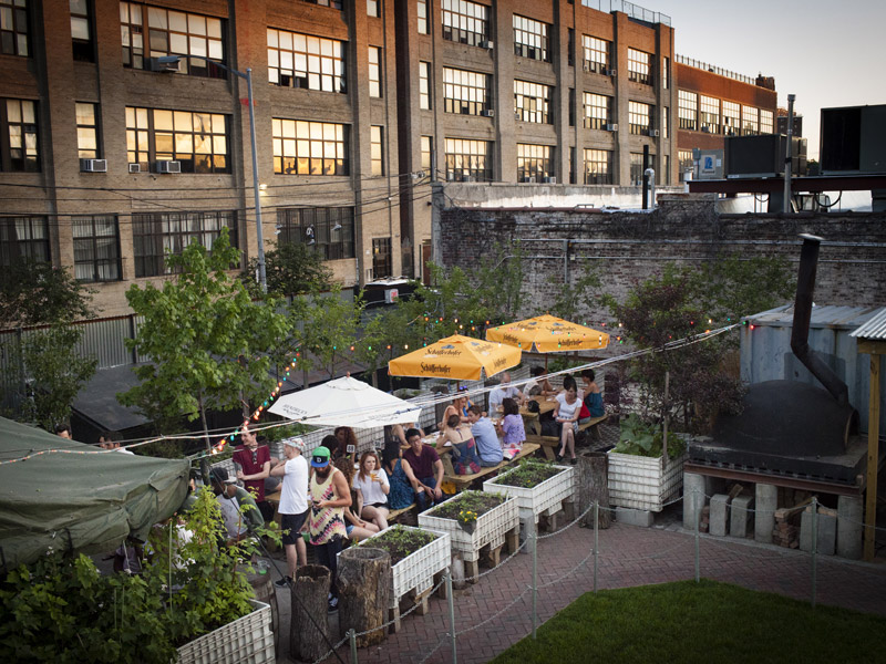 Robertas is hosting a massive pig roast in its awesome garden on Sunday night. Photo: Robertas Pizza