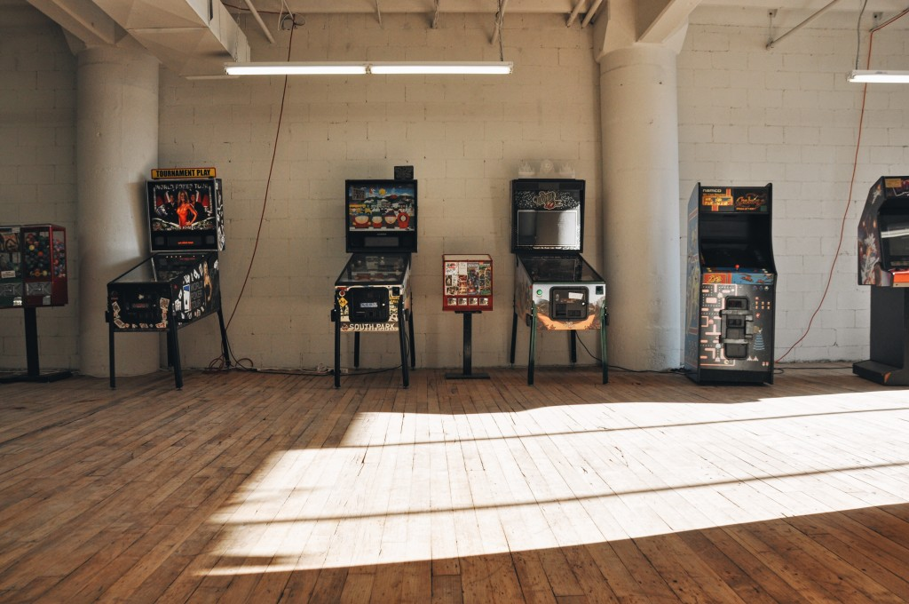 Before you head upstairs to the Flea, hand over your coat at coat check and try your hand at some old school games in the mini-arcade. Photo: