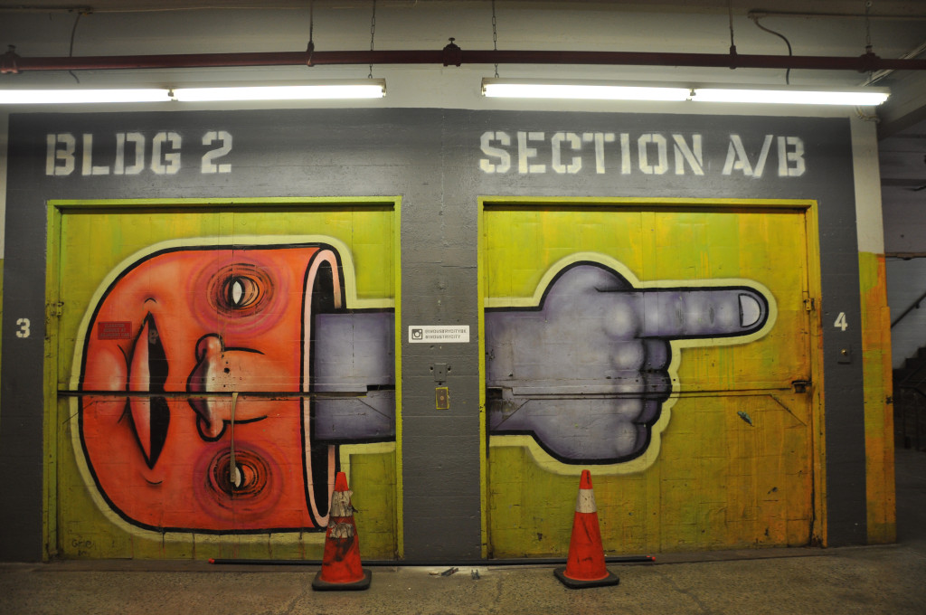 Bizarre, vibrant murals with characters reminiscent of the work of Os Gemeos cover the walls through out Food Hall, in addition to black and white photographs of Industry City dockworkers in the early 1900's.