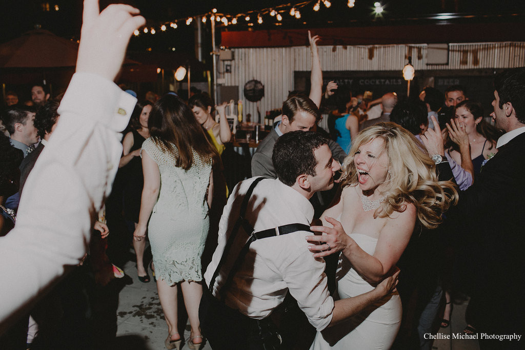 A happy bride and groom who booked MIXTAPE: A cover band for hipsters for their wedding. Photo: Chellise Michael Photography