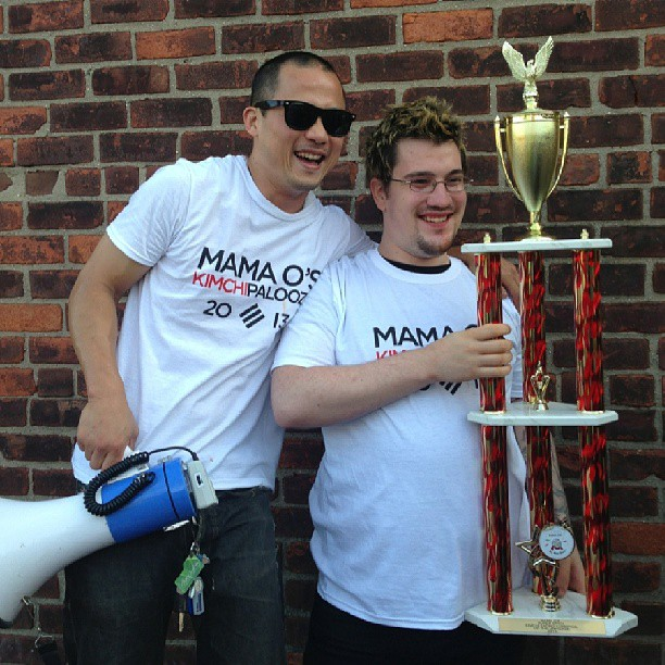 The winner of last year's kimchee eating contest took home a massive trophy. Photo: Mama O's