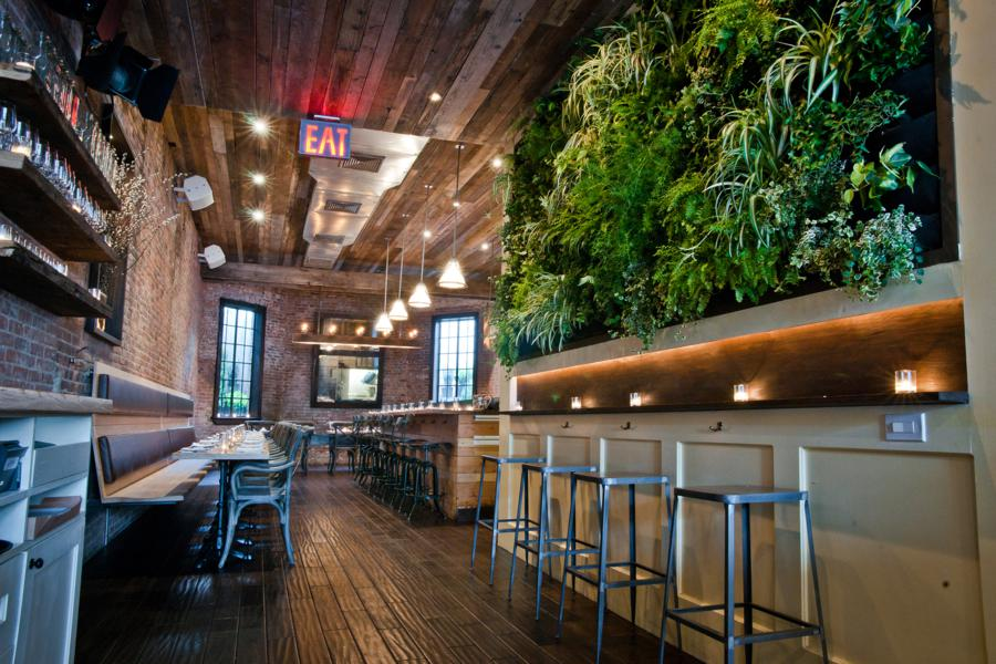 Reclaimed wood, a living wall, industrial stools, when you dine at Colonie, you know you are in Brooklyn. Photo: Colonie