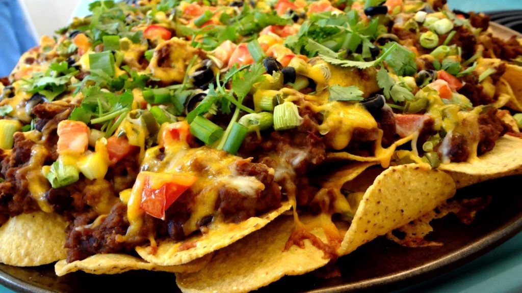 We can come together on nachos, yes? They're gluten-free, easily vegetarian or vegan, delicious no matter what and that big football game is this weekend.